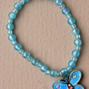 Ensemble collier et bracelet bleu pendentif papillon