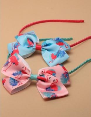 Serre-tête gros noeud en tissu imprimé flamant rose