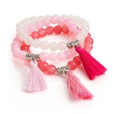 Trio de bracelets à pompon rose